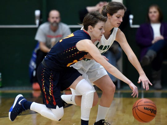 Seton Catholic's Brooke Gray reaches for the ball against Randolph Southern's Elizabeth Deckard Tuesday, Dec. 20, 2016 during a basketball game in Lynn.