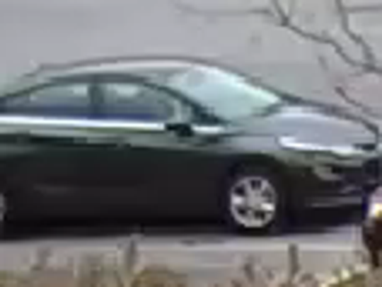 The suspect entered a newer model black four-door Sedan with distinctive chrome trim around the windows.