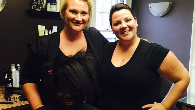 Nicole Oechsner, left, owner of The Renaissance and Jessica Lueck Rich, owner of The Renaissance, pose with Cleo, a Little in the Big Brothers Big Sisters program.