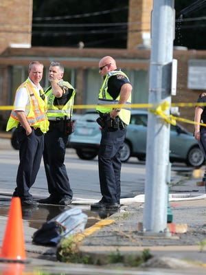 Wisconsin State Patrol and Kaukauna Police Department investigators work at the intersection of Crooks Avenue and Second Street in Kaukauna where a school bus struck a child Tuesday afternoon.