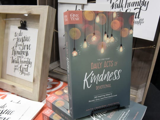 """The One Year Daily Acts of Kindness Devotional"" is part of a display during a conference Friday, Oct. 13, at the River's Edge Convention Center in St. Cloud."