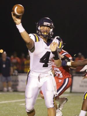 Carencro quarterback Carl Randall throws against Teurlings on Friday.