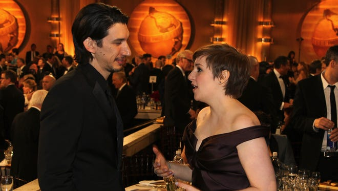"Adam Driver, left, and Lena Dunham talk at the  Golden Globe Awards in 2013. The two star on ""Girls."""