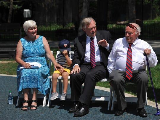 De Knudson sits next to her grandson, husband Dave