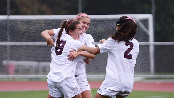 Ridgewood players celebrate after scoring a goal in Sunday's 3-0 win over Holy Angels in the Bergen County Girls Soccer Tournament.