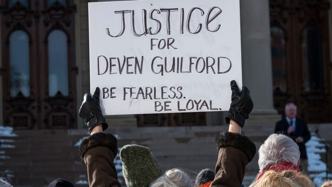 People protest the killing of Deven Guilford at the State Capitol Saturday February 27, 2016 by an Eaton County Sheriff sergeant last year. The event marked the one-year anniversary of his death. Eaton County settled a lawsuit against the sergeant in November 2017 for $2.4 million.