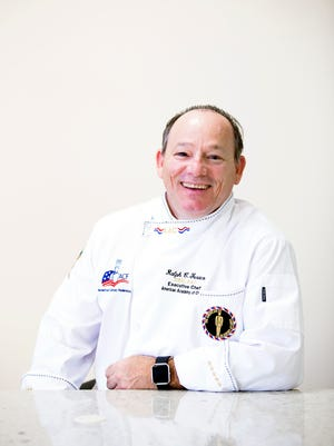 Chef Ralph Feraco, executive chef at the Kensington Golf & Country Club, poses for a portrait in the new demonstration kitchen at the Greater Naples YMCA on Monday, November 21, 2016 in North Naples. Chef Feraco has won international gold and silver medals in  at the Culinary Olympics in Erfurt, Germany in addition to numerous other culinary awards.
