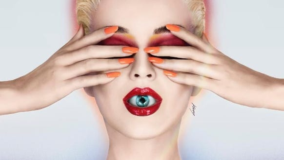 Bear 'Witness' to Perry's new trippy cover art.