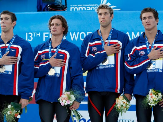 Nathan Adrian, right, of Bremerton, has been a member of Team USA's world championships since 2009, when he helped the US win the 4x100 medley relay along with, from left, Michael Phelps, Ryan Lochte and Matt Grevers.