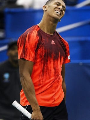 February 9, 2016 — American Michael Mmoh reacts after losing a point to fellow American Taylor Fritz during the second day of the Memphis Open at the Racquet Club in East Memphis Tuesday afternoon. Fritz defeated Mmoh 6-3, 6-4. (Mark Weber/The Commercial Appeal)