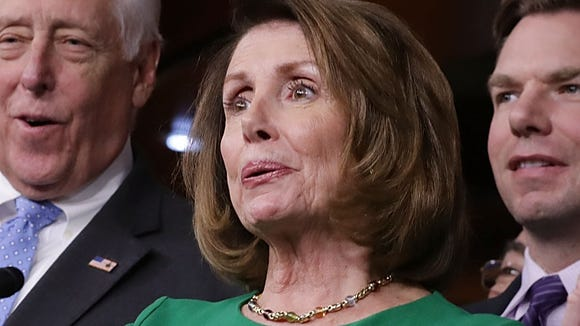 House Minority Leader Nancy Pelosi (D-CA) (C) is joined