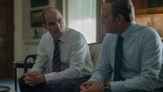 """Michael Kelly, left,  as Doug Stamper and Kevin Spacey as Frank Underwood return  in the second season of """"House of Cards."""""""