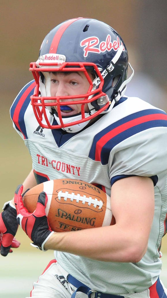 Tri-County running back Ryan Cothern runs the ball for the Rebels.