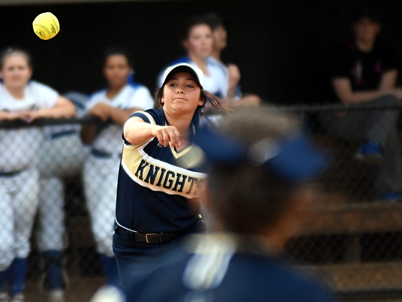 Pope John Paul II High senior Savannah Brown throws to senior second baseman Amanda Kuban at first base for a first-inning putout.