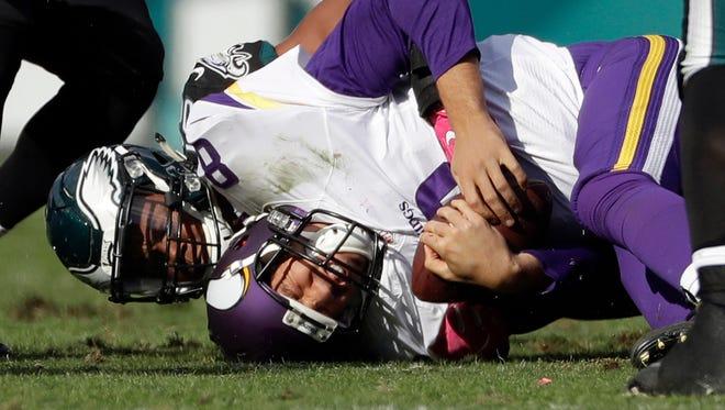 Minnesota Vikings' Sam Bradford (8) is tackled by Philadelphia Eagles' Jordan Hicks during the second half of an NFL football game, Sunday, Oct. 23, 2016, in Philadelphia.