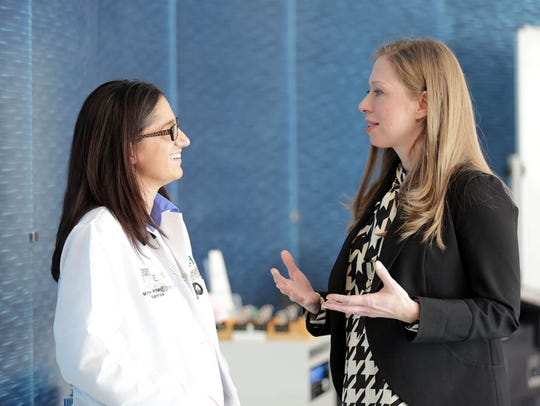 FILE -- Chelsea Clinton, right, visits Hurley Children's Center in Flint with pediatrician Dr. Mona Hanna-Attisha.