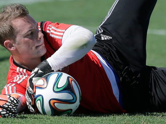 German national soccer goalkeeper Manuel Neuer catches a ball during a training session in Santo Andre near Porto Seguro, Brazil, Wednesday, June 11, 2014. Germany will play in group G of the 2014 soccer World Cup. (AP Photo/Matthias Schrader)