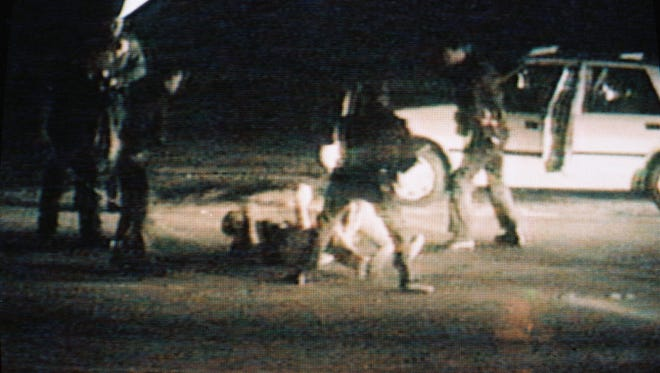 Picture taken from a CBS Television broadcast March 15, 1991, showing the March 3, 1991 incident in Los Angeles in which Rodney King (on ground) was beaten by police officers.
