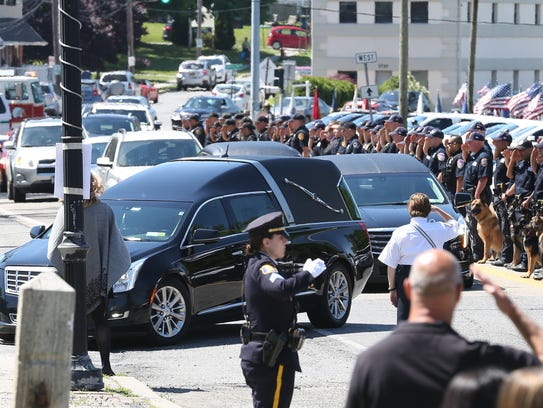 The funeral procession for Carmel police officer Gary