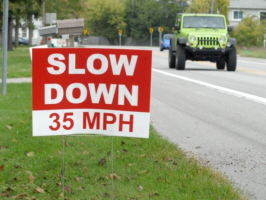 636118887295629166-Slow-down-sign.jpg