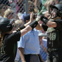 Sammy Buerger (16) of Oshkosh North leaps celebrating with Sydney Supple (11) at home base in the 4th inning of a WIAA Regional championship game against Beaver Dam on Monday, May 30, 2016.