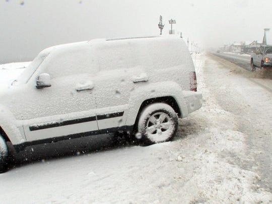 A snow plow works along Ocean Avenue in Belmar Thursday morning.