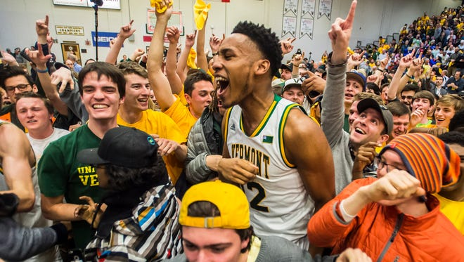 Center, Darren Payen celebrates after UVM won the America East Champsionship 56-53 over Albany at Patrick Gym in Burlington, Vt., on Saturday, March 11, 2017, moving them into the first round of the NCAA Tournament.