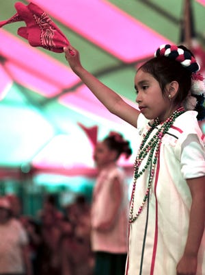 Natalia Lara, 7, performs a Mexican Folkloric dance at the annual Cristo Rey Church Fiesta Saturday.