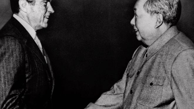 President Richard Nixon shakes hands with Communist Chinese leader Mao Tse-tung during Nixon's historic trip to China on Feb. 21, 1972, in Peking.
