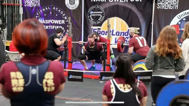 William Baken, surrounded by Pitt Powerlifting teammates, competes during the National Academy of Strength Powerlifting Championship in Bakersfield on Saturday, January 23.