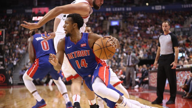 Pistons guard Ish Smith (14) goes to the basket against Raptors center Jonas Valanciunas on Tuesday, Oct. 10, 2017, in Toronto.