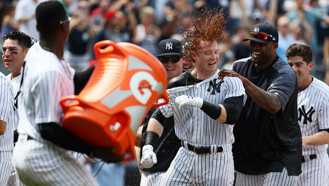 Clint Frazier of the New York Yankees celebrates a three-run walk-off home run in the ninth inning against the Milwaukee Brewers on Saturday.