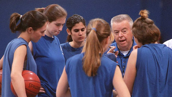 Tom Pryor coaches the Asheville School girls in this 1996 photo.