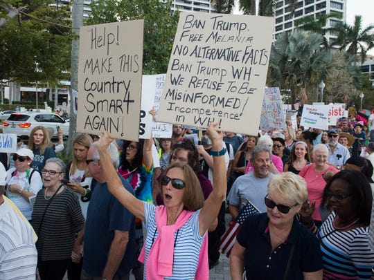 Thousands of anti-Trump protesters lined Flagler Drive to participate in the March to Mar-a-Lago which started in front of Trump Plaza on Saturday, Feb. 4, 2017, in West Palm Beach. President Donald Trump and First Lady Melania Trump were at their Mar-a-Lago estate in Palm Beach for the 60th annual Red Cross Ball. The march was organized to protest Trump's policies.