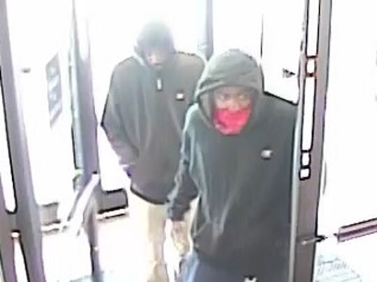 Surveillance footage showing two suspects wanted in