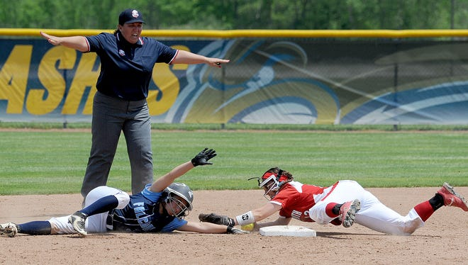 Hillsdale's Keirah Smetzer slides safely into second base as Plymouth's Janet Arnold is late applying the tag.