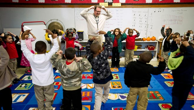 Treadwell Elementary School music teacher Ed Murray leads kindergarten students as they dance and sing songs in English and Spanish on Jan. 10, 2014. The class is part of Treadwell's dual language optional program.
