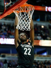 Big East's Mitchell Robinson dunks against Big West's