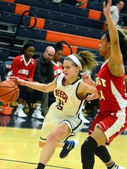 Beech High junior guard McCall Decker dribbles into