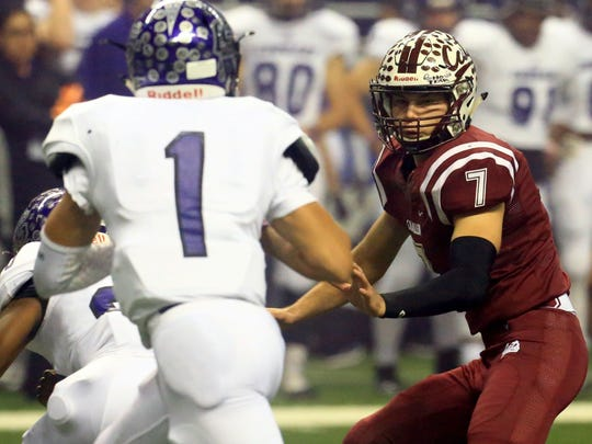 Calallen's Lawrence Mann chases College Station's Marquez Perez during the Class 5A Division II state semifinal Friday, Dec. 9, 2016, at the Alamodome in San Antonio.
