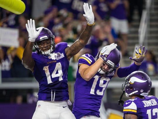 Vikings receiver Stefon Diggs (14) celebrates his touchdown