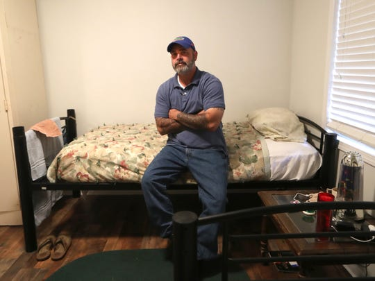 """Thomas Nichols sits on the bed in his room at the home, where he is working to re-enter society after serving a prison sentence for a sexual offense against a minor. """"Who wouldn't want the 85 percent success rate? here is a program offering an 85 percent chance,"""" said Nichols about how the program was pitched to him."""