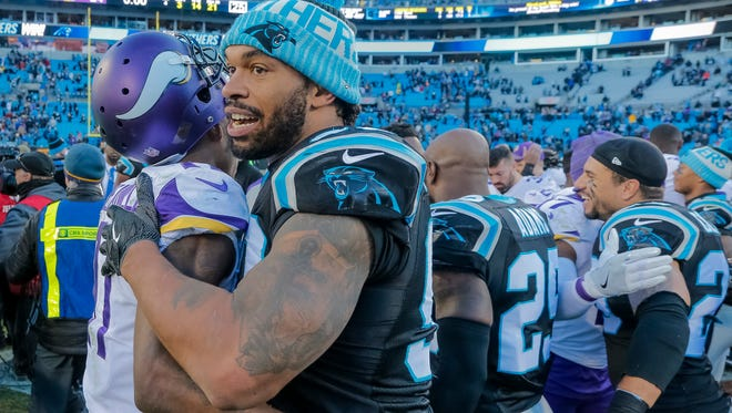 The Carolina Panthers' Julius Peppers (right) greets the Minnesota Vikings' Laquon Treadwell after their game in Charlotte, N.C., on Sunday, Dec. 10, 2017.
