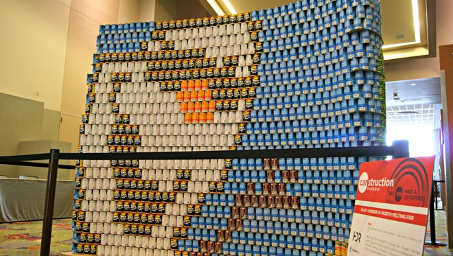"""""""Hunger is worth melting for,"""" is the title for this 2-D recreation of Olaf form the film """"Frozen"""" made by HDR, CH2MHill and Sundt for   Canstruction at the Phoenix Convention Center Wednesday, July 22, 2014."""