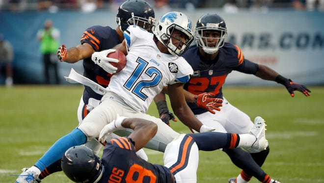 Lions receiver Andre Roberts collides with Bears safety Adrian Amos after receiving a pass Sunday, Oct. 2, 2016, in Chicago.