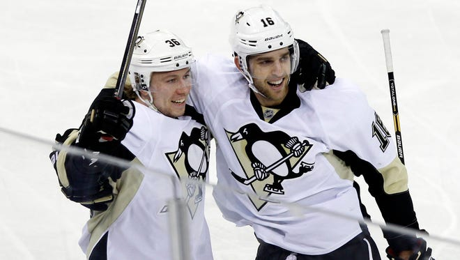 Penguins left wing Jussi Jokinen congratulates center Brandon Sutter after scoring against the Rangers during the third period at Madison Square Garden.