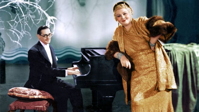 """Sophie Tucker at the piano with her longtime accompanist Ted Shapiro, circa 1934. Pomona couple Susan and Lloyd Ecker have made a documentary about Tucker, known as """"the last of the Red Hot Mamas."""""""