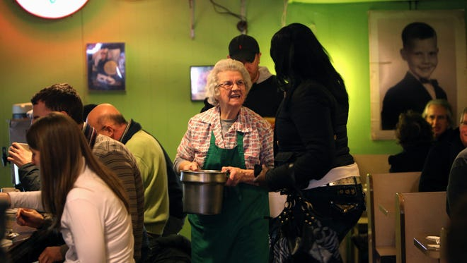 Maynie Tucker in 2011 at age 90. She talks to patron Loria Artis. It was the first day the restaurant re-opened after gunmen shot owner Carla Tucker, and an 18-year-old customer Ranisha Burgin.