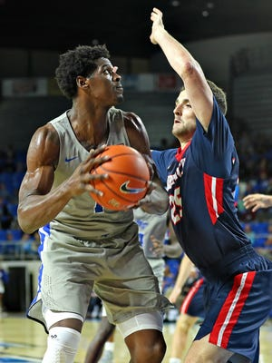 MTSU forward Brandon Walters looks to score in a game against Belmont at Murphy Center on Nov. 16, 2017.