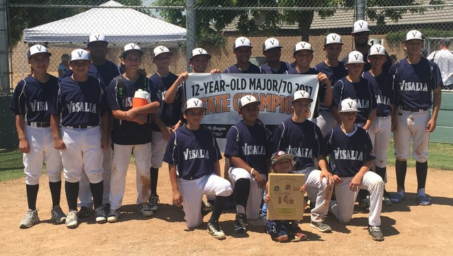 The Visalia 12U Blue All-Stars defeated Bullard this past weekend to win the Cal Ripken state title. Pictured, top row, left to right: Assistant coach Nick Lopez, Alex Lopez, Coach Domingo Lopez, Reece Bueno, Zach Mell, Ty Potts, Isiah Flores, DeAndre Mitchell, Joey Rico, Cooper Schimpf, Andrew Lunsford, Manager Matt Rico, Taylor Maxey, Silas Garcia; bottom row, left to right: Ace Kee, Daryl Tillman, Jayce Ford, Bo Rico and mascot Devon Valdez.